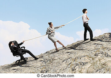 Three business people pulling rope - Image of three...