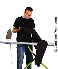 Ironing Mistake - A man looking at a spot on his pants where...
