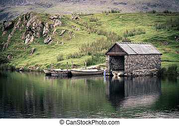 Boathouse - An old stone boathouse on a lake in Snowdonia,...