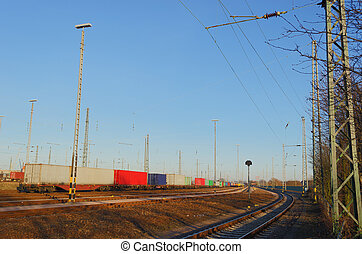 Train on freight yard - A freight yard under a beautiful...