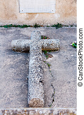 Stone cross in cemetery - Stone cross on a grave in the...