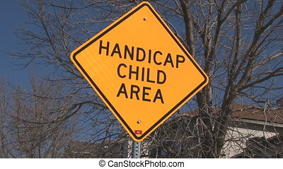 Handicap Child Sign with trucking right to left