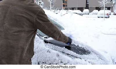 man clean snow car brush