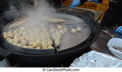 dumplings bake big pan - Dumplings fry bake in hot huge pan...