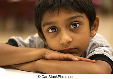 An Indian Boy - An Indian boy looking tired