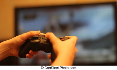 Boy using video game controller isolated on white