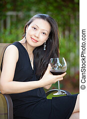 Cheers - An asian woman drinking red wine