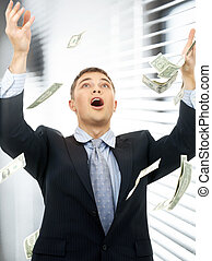 businessman in money rain indoors - happy successful...