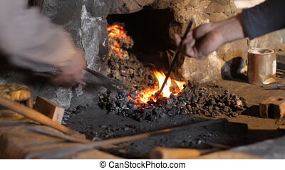 Blacksmith working - Blacksmith work The blacksmith does...