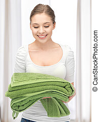 lovely housewife with towels - bright picture of lovely...