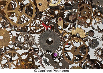 watch parts - many parts and cog from a watch looking down...