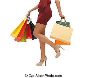 long legs with shopping bags - picture of womans long legs...