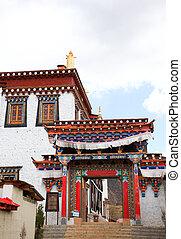 Colorful gate in Songzanlin Monastery in Zhongdian (Shangri-La), Yunnan, China
