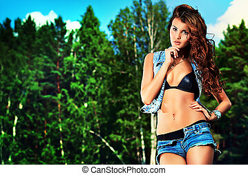 country - Shot of a sexy woman posing outdoor.