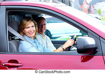 Happy senior couple in the car Transportation