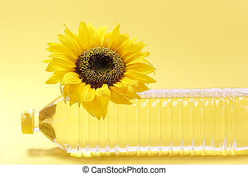 Oil bottle - Sunflower with cooking oil bottle on yellow...
