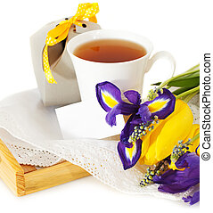 Tea with flowers and gift box for mom in Mothers Day