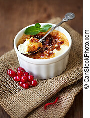 Creme brulee cream brulee, burnt cream with red currant and...
