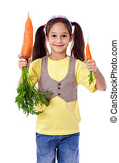 Smiling girl with two carrots