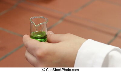 pipetting green specimen - before analysing the specimen a...