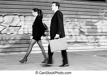 Business people walking in the street. Couple working -...
