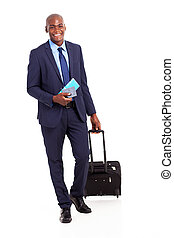African business traveler with trolley bag and air ticket