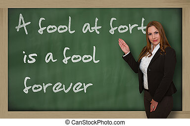 Teacher showing A fool at forty is a fool forever on...