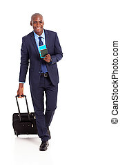 african american business traveller walking on white