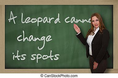 Teacher showing A leopard cannot change its spots on...