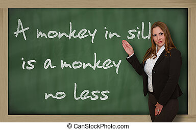 Successful, beautiful and confident woman showing A monkey...