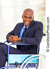 optimistic handicapped african businessman sitting on...
