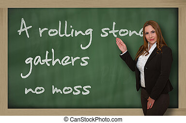 Teacher showing A rolling stone gathers no moss on...
