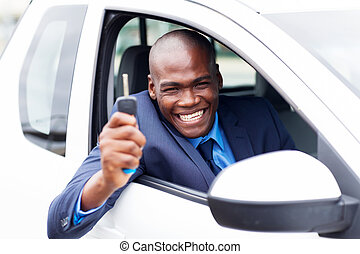 african vehicle buyer inside his new car - happy african...