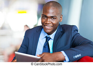 african businessman using tablet