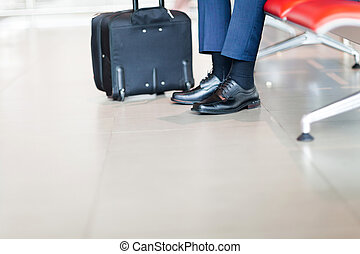 businessman waiting for flight at airport