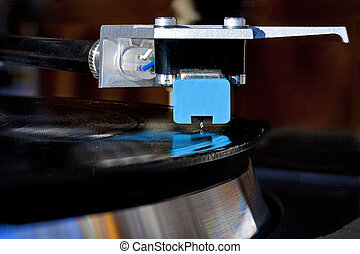 Record player plays vinal - This needle rides in the groove...