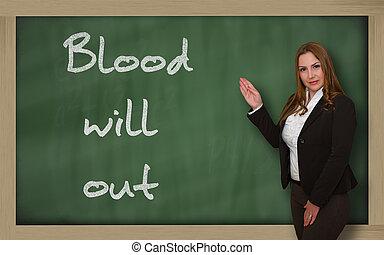 Teacher showing Blood will out on blackboard - Successful,...
