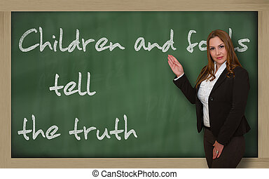 Teacher showing Children and fools tell the truth on...