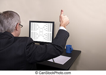 March Madness Businessman Thumbs Up - A businessman giving...