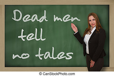 Teacher showing Dead men tell no tales on blackboard -...