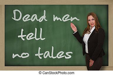 Teacher showing Dead men tell no tales on blackboard -...