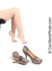 Portrait of heels with woman legs in the background