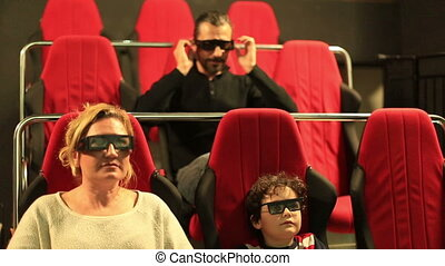 3D - 5D movie - family watching 5D movie
