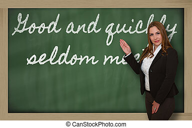Teacher showing Good and quickly seldom meet on blackboard -...