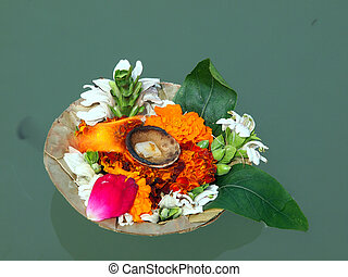 flowers on the ganga - flowers and candle for the god wishes...