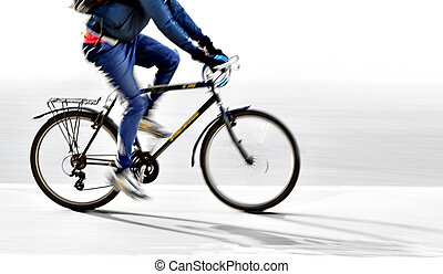 Young man on bike - young man on bike in blurred motion