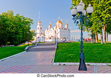 Street lamp post in the park of the Assumption Cathedral -...