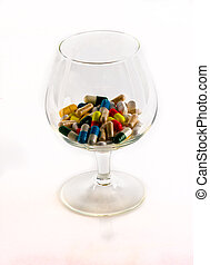 wineglass with pills