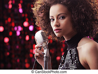 Young Rock star - Young female singer with brown curly hair...