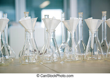 Flask in a pharmacology laboratory - Row of flasks in a...